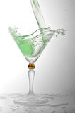 Liquid in cocktail glass. Pouring liquid into cocktail glass Royalty Free Stock Photos