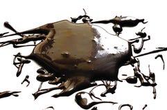Liquid dark chocolate. Isolated on white background Stock Image