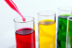 Liquid dripping from pipette into test tube Stock Images