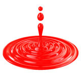 Liquid drop, red color isolated on white background Royalty Free Stock Images