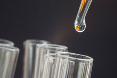 Liquid drop on test tube Royalty Free Stock Photos