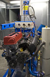 Liquid Flow Dynamometer. Engine mounted on a liquid flow dynamometer in a tuning shop Stock Photos