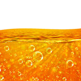 Liquid flows orange Wave, Sea, close-up Air Bubbles, Beams Royalty Free Stock Images