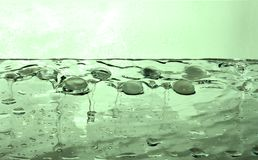 Liquid gem emerald green water. Liquid gems emerald green water drops Royalty Free Stock Photo