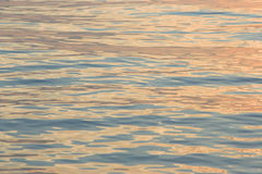 Liquid gold. Rippled golden sea surface with reflections of sunrise Royalty Free Stock Photography