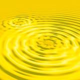 Liquid Gold. Splash waves background Stock Photo