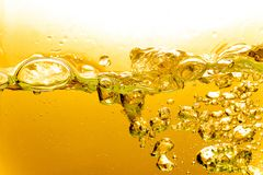 Free Liquid Gold Bubbles In Water Or Oil Stock Images - 129703944