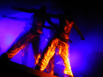 Liquid gold dance performers. Male dancers in golden dresses, picture taken without any photographic or photoshop filters, time exposure only stock image