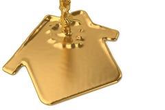 A liquid gold metal house symbol sign.3D illustration. Stock Photos