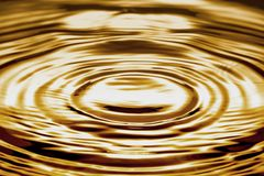 Liquid gold ripple or water. Abstract background texture royalty free stock image