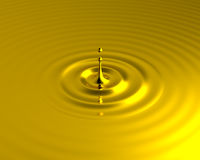 Liquid gold splash with ripples Stock Photos