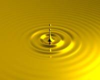 Liquid gold splash with ripples Stock Photos