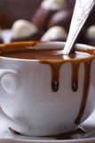 Liquid  hot chocolate is splashed out cup closeup vertical Royalty Free Stock Photography