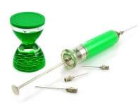 Liquid hourglass, syringe and needles. Liquid hourglass, syringe with toxic substance and needles isolated Stock Images