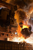 Liquid iron from the ladle. Smelting metal in a metallurgical plant. Liquid iron from the ladle Royalty Free Stock Images