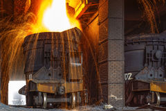 Liquid iron from ladle. In the steelworks Royalty Free Stock Photo