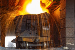Liquid iron. From ladle in the steelworks Stock Photo