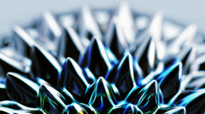 Liquid iron. Photo of an interesting, colorful chemical ferrofluid Stock Images