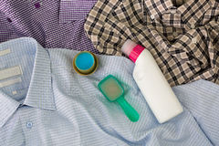 Liquid laundry washing detergent, blue softening liquid, pre was. Spoon cap full of liquid laundry washing detergent, blue softening liquid, bottle of pre wash stock photo