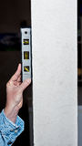 Liquid level on a beam to insure it is straight. Level used to check the straightness of a pillar Stock Photography