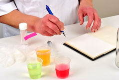 liquid and make some notes in a book Royalty Free Stock Photo