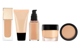 Liquid makeup foundation in bottle and face powder isolated on w. Hite background stock image