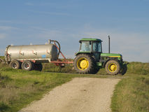 Liquid manure tanker. Tractor with a liquid manure tanker passing by Royalty Free Stock Photo