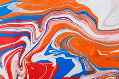 Liquid marbling acrylic paint background. Fluid painting abstract texture stock image