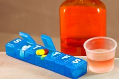 Liquid medication and pills Royalty Free Stock Image