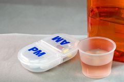Liquid medication and pills Royalty Free Stock Images