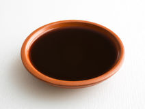 Liquid mesquite flavor in a small bowl Stock Photos