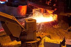 Liquid metal from blast furnace. At metallurgical plant workshop stock photos