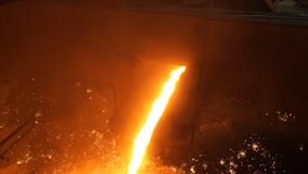 Liquid metal from blast furnace. Liquid iron from ladle in the steelworks Stock Photography