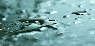Liquid metal drops banner. Website banner of abstract blue liquid metal drops Royalty Free Stock Images