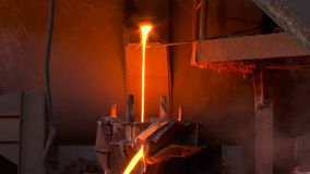 Liquid Metal In The Foundry. Processing of copper ore in the foundry,liquid metal is poured into molds stock video