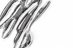 Liquid metal. Silver liquid metal on a white background stock image