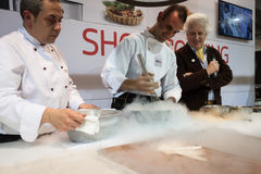 Liquid nitrogen cooking at Golosaria 2013 in Milan, Italy Royalty Free Stock Photos