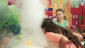 Liquid nitrogen experiment for kids. Fancy show for children. Kids entertainment in kids club stock footage