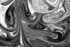 Liquid paints mixed together creating black and white abstract stock photos