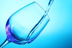 Liquid pouring into the glass Stock Image