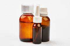 Liquid remedy in bottles. Royalty Free Stock Images