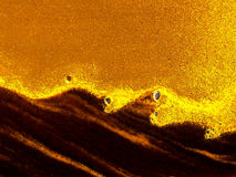 Liquid sandstorm. Abstract of yellow sand waves - sandstorm with copy space Stock Images