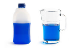 Liquid screenwash in plastic bottle and glass jug Stock Images