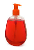 Liquid soap. Bottle of red liquid soap isolated on white royalty free stock image