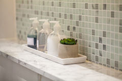 Liquid soap bottle with tile background Bathroom accessories. Modern Liquid soap bottle with tile background Bathroom accessories Royalty Free Stock Photos
