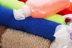 Towels and liquid soap bottles Stock Photo