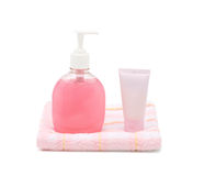 Liquid soap, cream tube and towel Stock Image