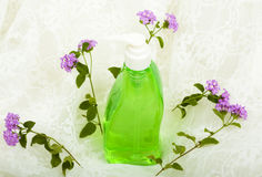 Liquid Soap and Flowers on White Lace Royalty Free Stock Photos