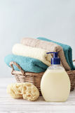 Liquid soap, sponge and towels Stock Photos