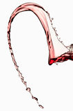 Liquid Spilling from Wine Glass Stock Image